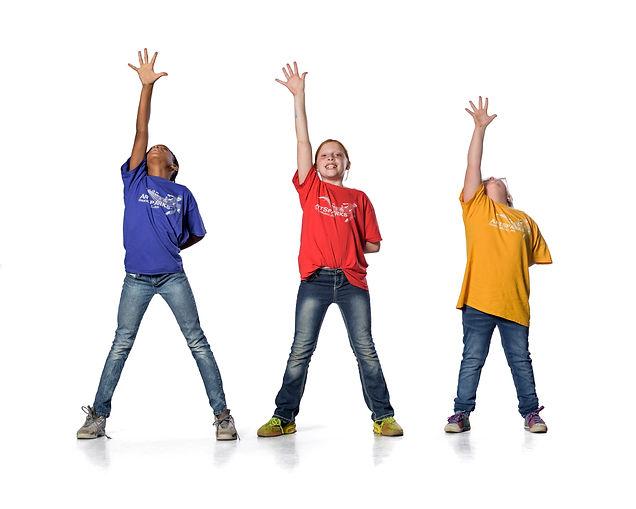 Three dancers reaching up