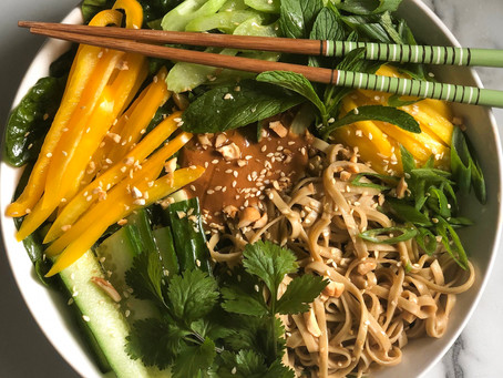 Cold noodle salad with cilantro, mint, and spicy peanut sauce