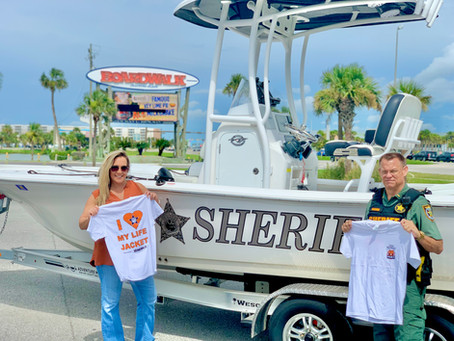 """The Boardwalk sponsors the OCSO Marine Unit's """"WEAR-IT"""" Safe Boating Campaign."""