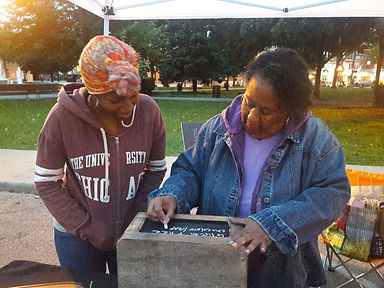 My mom and daughter helping me set up at a farmers market