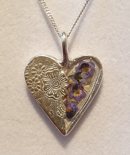 Silver patterned heart with forget-me-not flowers in resin on one side