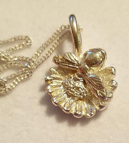 Silver bee on mini sunflower