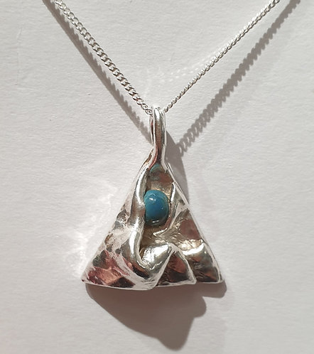 Silver triangle with folds and blue cabochon