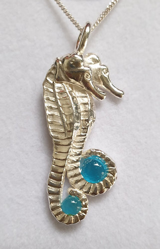 Silver seahorse twin with light blue cabochon