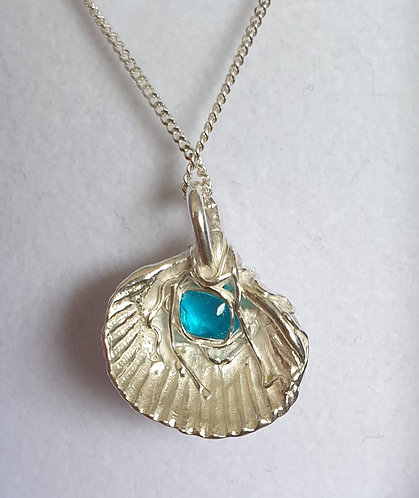 Silver shell with blue cabochon