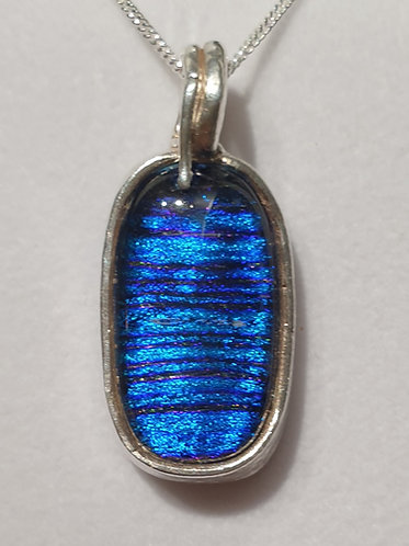 Blue oval cabochon in silver surround
