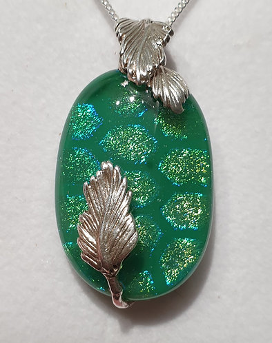Green oval cabochon with silver leaves