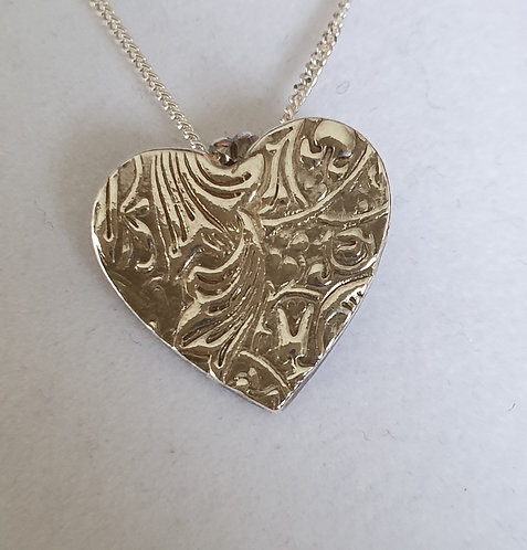 Silver patterned heart