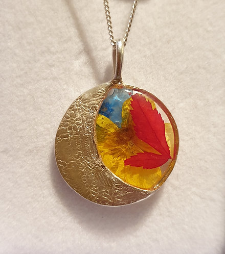 Silver moon shape with multi-colour flowers in resin