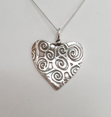 Silver heart with swirl pattern