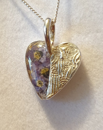 Silver patterned heart with forget-me-not flowers in resin on one half