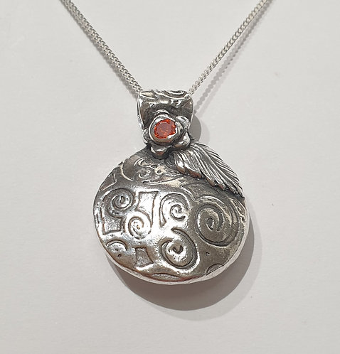 Silver patterned abstract lentil with red CZ