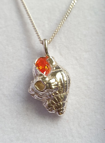 Silver conch with amber CZ