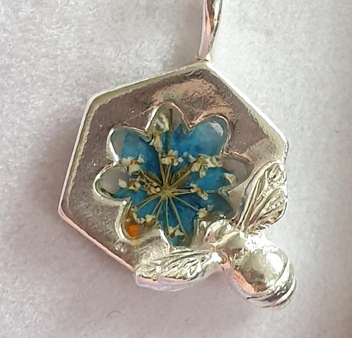 Silver bee on hexagon shape with blue flower in resin