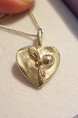 Silver bee on heart pattern on reverse