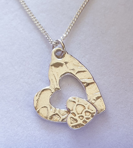 Silver heart with cut out and small heart on lower part patterned