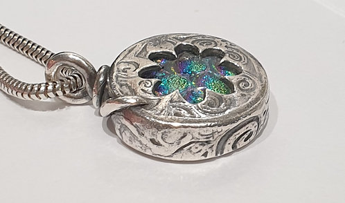 Large round silver box with multi coloured cabochon inside