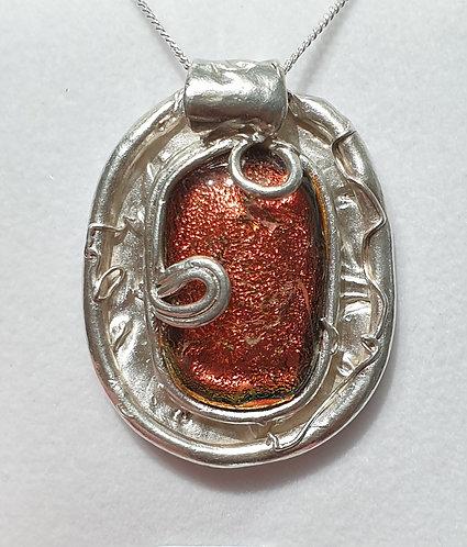 Copper cabochon in silver surround