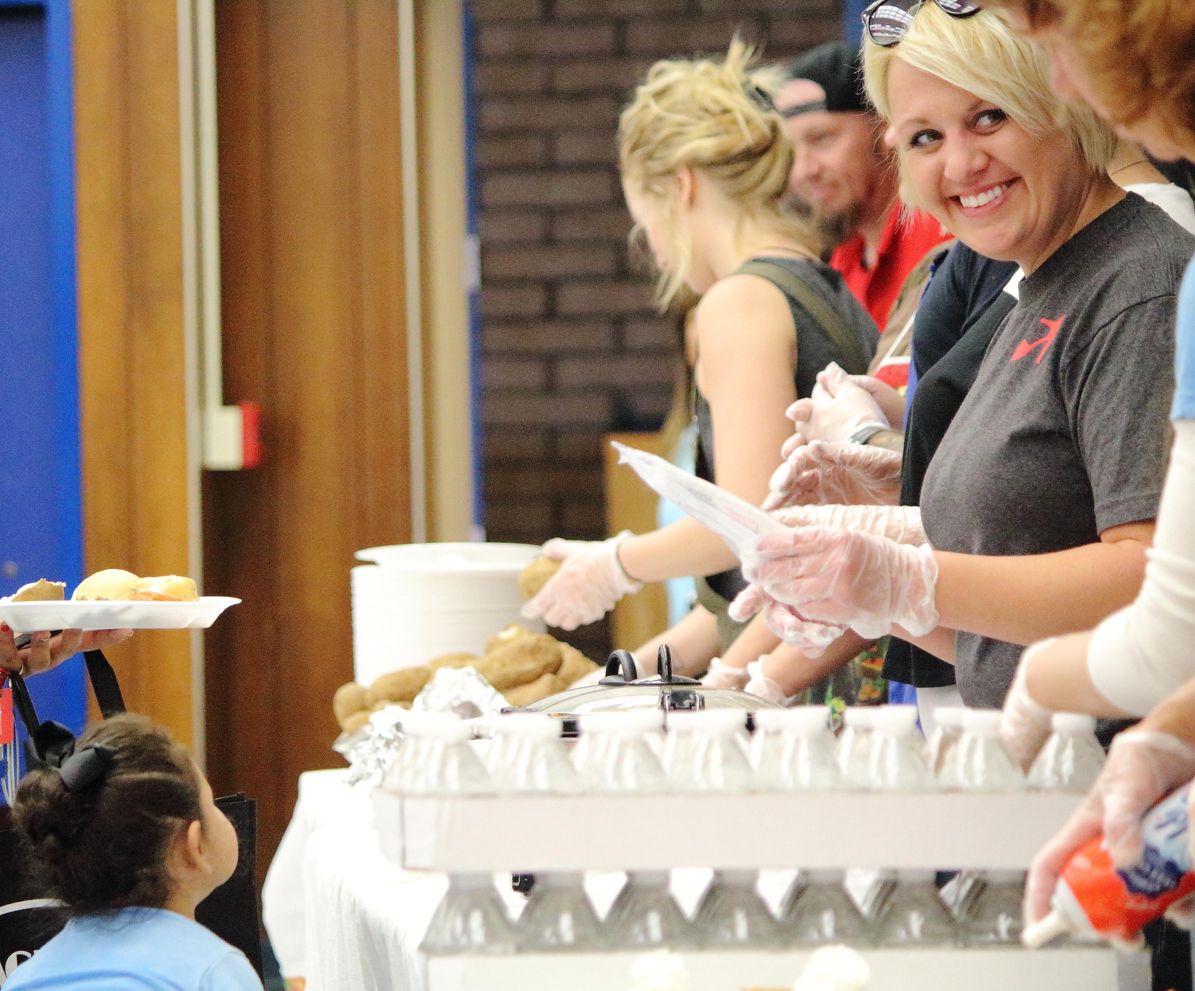 smiling serving line