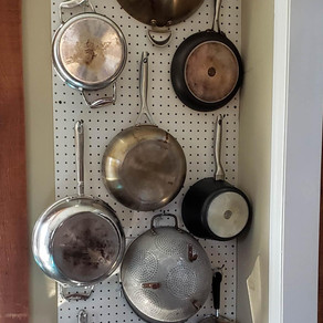 Kitchen Tip: Hang Pots and Pans on Pegboard to Maximize Space.