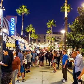 Crowd in line at food vendor booths on a summer night at Monday Night Market in Downtown Long Beach