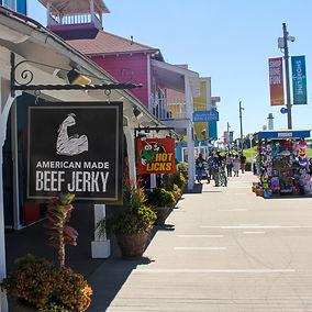 Visitors walking the Shoreline Village boardwalk shops and restaurants in Downtown Long Beach, CA
