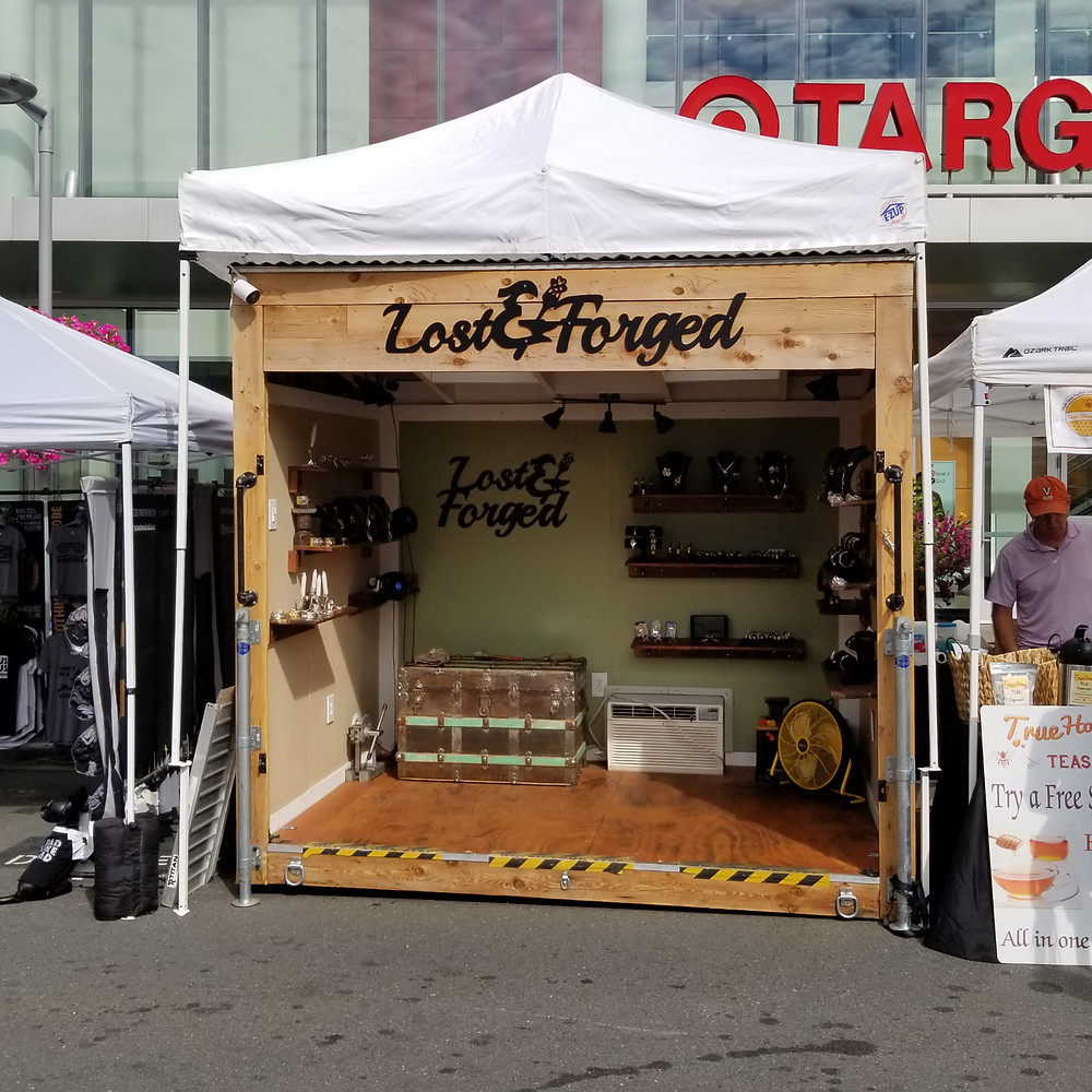 mobile boutique underneath white show tent
