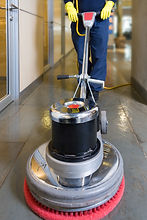 Industrial buffing machine polishing the floor in a hallway.jpg