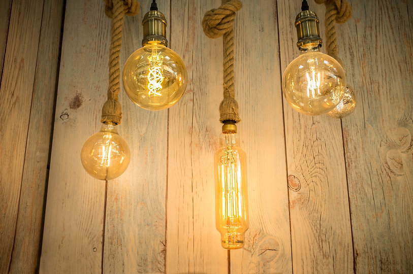 Rope light bulbs over weathered wooden b