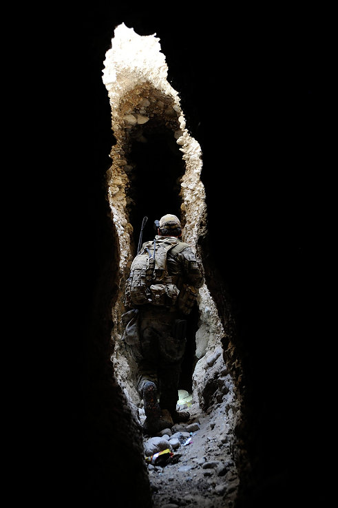 SOER Association Special Operations Engineer walking through caves