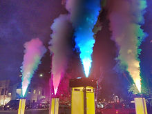 Rental of geyser Fog effect on Lighting wrapped truss at grand opening event.JPG