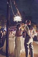 bride groom chandelier and bistro lighting wedding.jpg