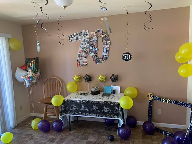 Surprise party with balloons and number 70 made up of pictures