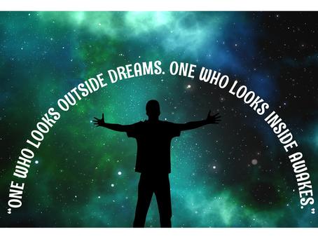 ''One Who Looks Outside Dreams. One Who Looks Inside Awakes.''