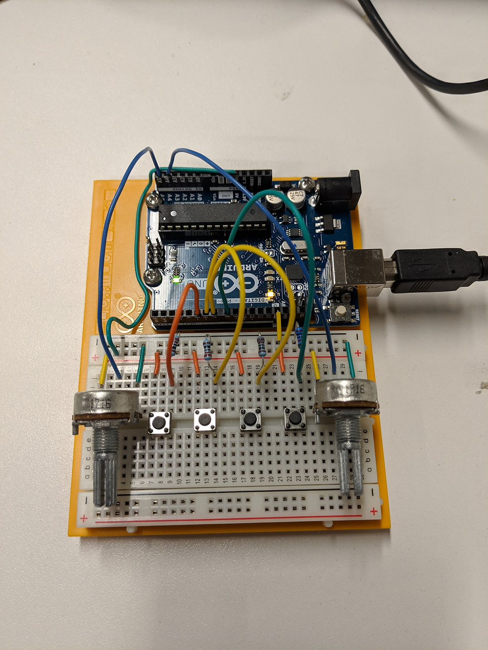 An Arduino Uno connected to a circuit