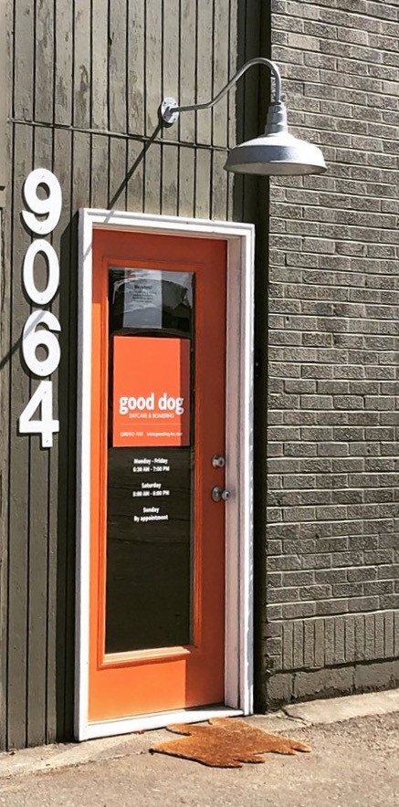 Good Dog Entrance - the sign indicating is visible - just just above the logo on the door.