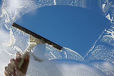 Window cleaner using a squeegee to wash