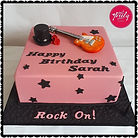 Gluten Free Rock themed cake with electric guitar and guns n roses hat