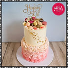 Two tier pink white 50th birthday cake