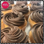 Gluten free white chocolate mud cupcakes topped with a whipped chocolate ganache swirl