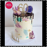 60th birthday cake topped with edible crystals & geode