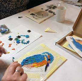 student creating mosaic kingfisher for h