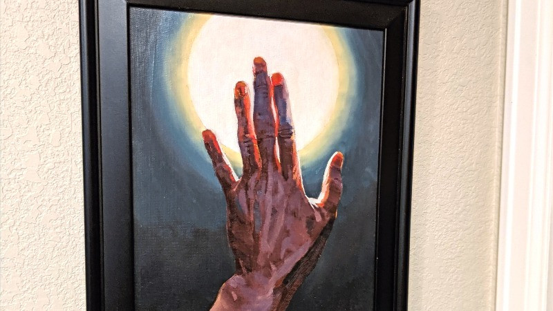 Open hand depicted in the light