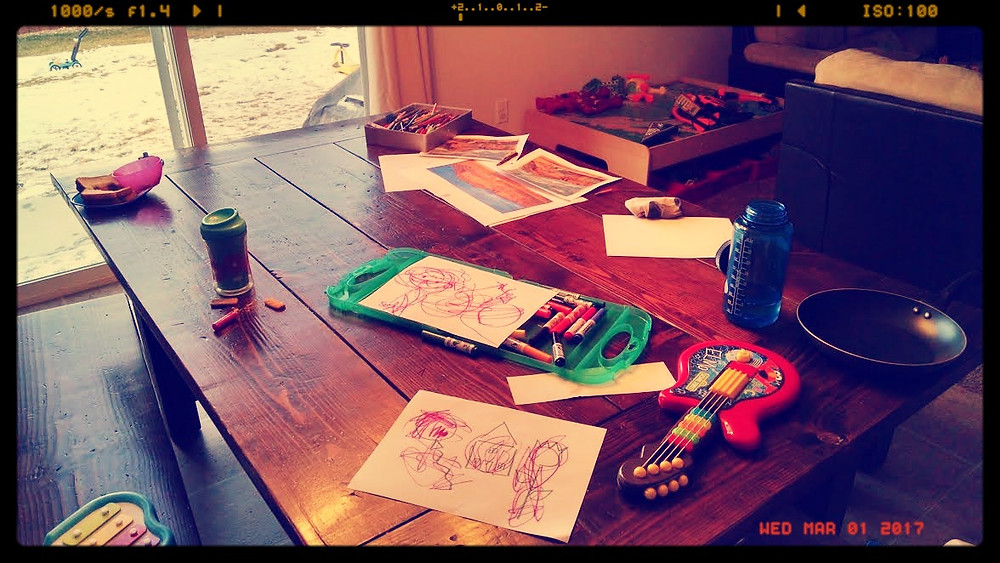 Our messy dining room table: my color sketches, toys, socks, half-eaten food from who knows when!