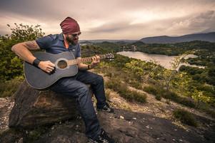 man guitar hike.jpg