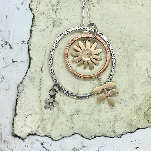 Pendant with large hoops - bronze embossed daisy