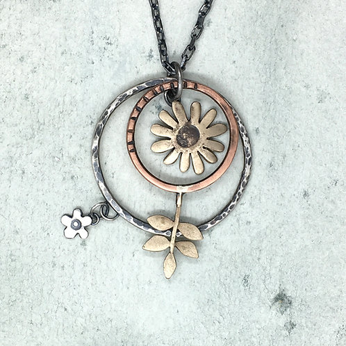 Pendant with large hoops - bronze embossed daisy and hammered hoop