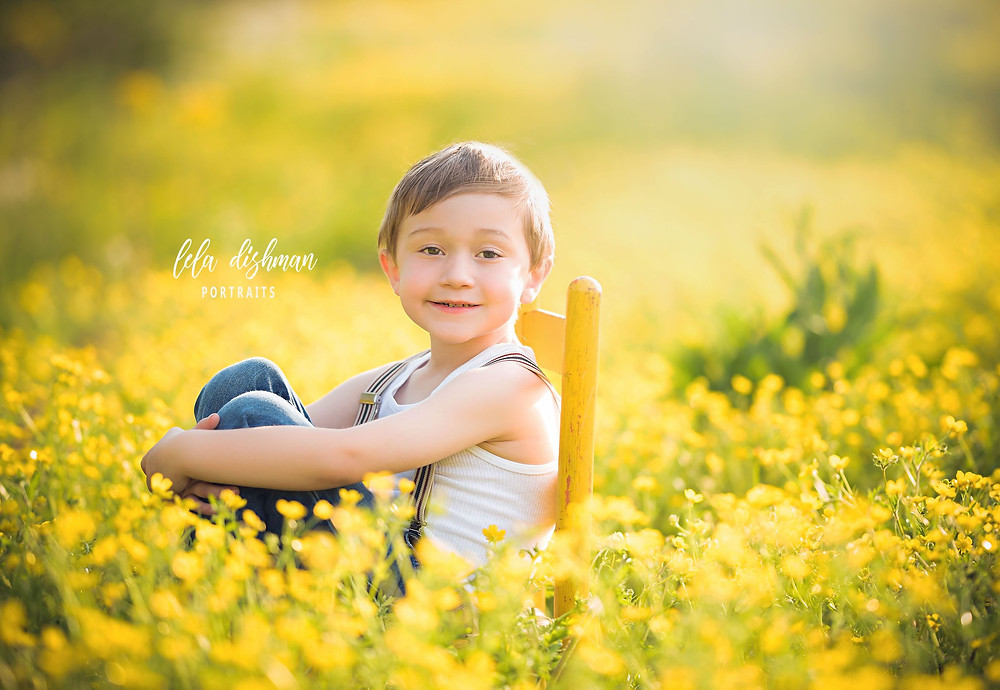 little boy wild yellow flowers photography
