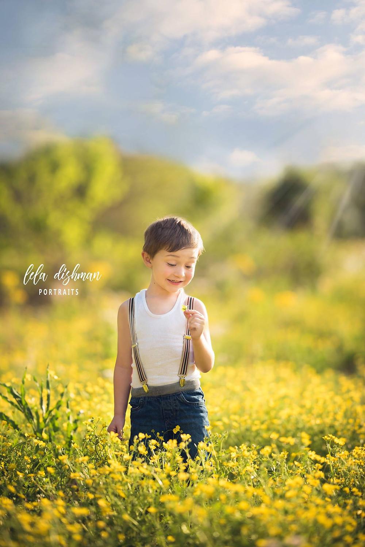 little boy wild flowers