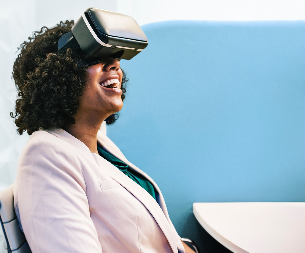 Woman smiling in her virtual office aventura